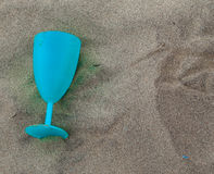 Wine glass on the sand Royalty Free Stock Photo
