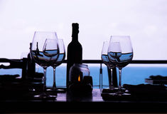 Wine glass and seaside restaurant Stock Photos