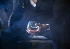 Wine glass. Seated Man with a glass of wine Stock Photo