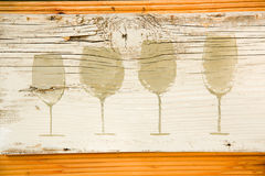 Wine glass silhouettes painted on board. Decoration of bar. Royalty Free Stock Image