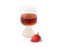 Wine glass and single strawberry. Isolated in white Stock Images