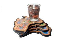 Wine glass on some souvenir coasters Royalty Free Stock Photos