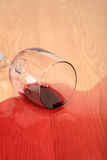 Wine glass spilled. Wine spilled on wood - red wine glass toppled over Royalty Free Stock Photo