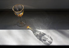 Wine glass for spirits drinks. Still life on the windowsill of wine glass for spirits drinks Royalty Free Stock Photo