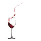 Wine glass splash and drops. Pouring red dry. Red dessert wine glass splash and drops. Pouring wine, splashing into crystal glass., close-up, white background stock photography