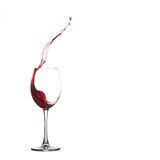 Wine glass splash. Pouring natural red grape. Pouring red dessert wine into glass, wine glass splash, close-up, white background. copy space royalty free stock photos