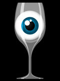 Wine glass with staring eye. Wine glass with blue staring eye Royalty Free Stock Photo