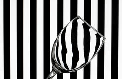 Wine glass on striped background Stock Photo