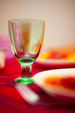 Wine glass on table Stock Images