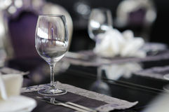 Wine glass on a table stock photos