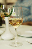 Wine glass in table restaurant. Glass of wine standing on table in beautiful restaurant Stock Image