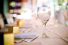 Wine Glass Table Setting. With cutlery and gift boxes Royalty Free Stock Photo