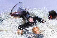 Wine glass and two bottle with corkscrew Royalty Free Stock Photos