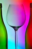 Wine glass and two bottles royalty free stock image