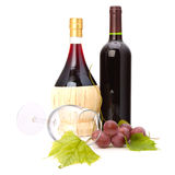 Wine glass and two wine bottles Stock Photos