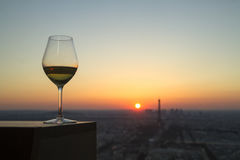 Wine glass with view on paris city at sunset Royalty Free Stock Image