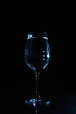 Wine glass with water. Wine glasses with water against a black background Stock Images