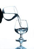 Wine glass water pouring to wine glass Royalty Free Stock Image