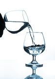 Wine glass water pouring to wine glass Stock Photography