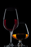Wine Glass and Whiskey Glass on black background.  stock images
