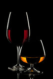 Wine Glass and Whiskey Glass on black background.  royalty free stock photography
