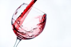 Wine in glass on white bacground. Wine in glass on white background stock photography
