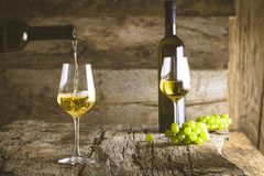 Wine on wood Stock Photography