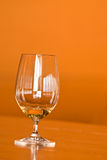 Wine glass with window reflections. Glass of white wine on a table Royalty Free Stock Photography