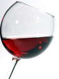 Wine glass with wine. Wine glass with red wine on a white background