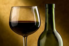 Wine Glass And Wine Bottle Stock Photos