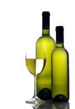 Wine glass and wine bottle. Isolated on white royalty free stock photography