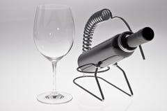 Wine Glass & Wine Bottle. In chrome bottle holder Royalty Free Stock Images