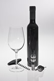 Wine Glass & Wine Bottle. Wine glass, bottle & accessories incl cork opener and wine stopper Stock Image