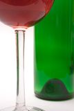 Wine Glass and Wine Bottle (Close View). Details of a wine glass and a green wine bottle in the background Stock Images