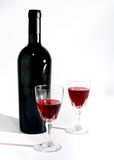 Wine glass and wine bottle still life isolated Stock Image