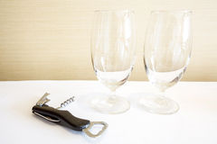 Wine glass and wine opener Stock Image