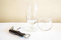 Wine glass and wine opener Royalty Free Stock Photos