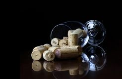 Wine glass with wine stoppers. Refflection background Royalty Free Stock Photos