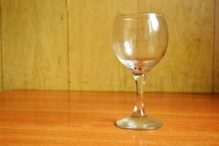 Wine glass on the wooden table Stock Photography