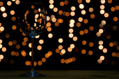 Wine glass on wooden table with dark and bokeh background Stock Images