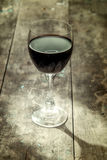 Wine glass on a wooden table Royalty Free Stock Image