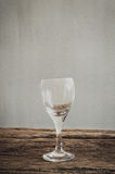 Wine glass on wooden tabletop Stock Photos