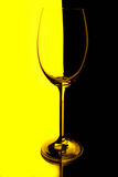 Wine glass with yellow and black backgroun Royalty Free Stock Photos