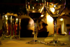 Wine Glasses. Wine and drinking glasses at restaurant table Royalty Free Stock Images