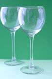 Wine glasses. Empty wine glasses on green isolated stock image