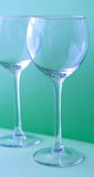 Wine glasses. Empty wine glasses on green isolated royalty free stock photo