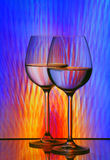 Wine glasses. Two wine glasses arranged against painting background Royalty Free Stock Photo