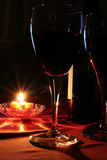 Wine glasses. Two Wine glasses, Wine bottle and candle Stock Images
