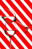 Wine glasses. Balanced wine glasses against striped abstract background Stock Photography