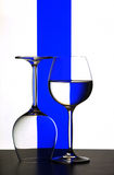 Wine glasses. A pair of wine glasses in front of a blue line Royalty Free Stock Photos